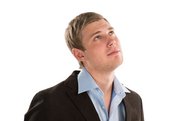 Successful young businessman looking away against white backgrou
