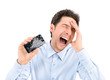 Leinwandbild Motiv Angry man showing broken smartphone