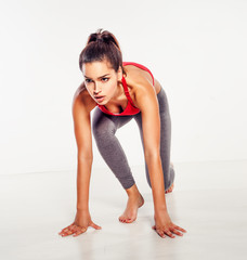 Athletic woman in starter position