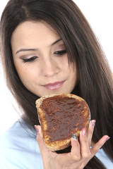 Model Released. Woman Eating Marmite on Toast