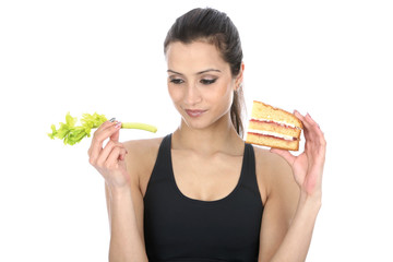 Model Released. Woman Holding Cake and Celery