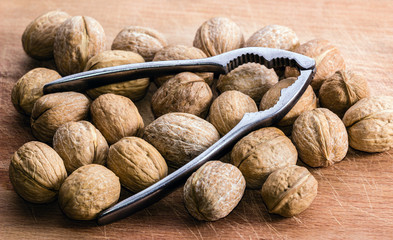 Walnuts and Nutcracker on a Cutting Board