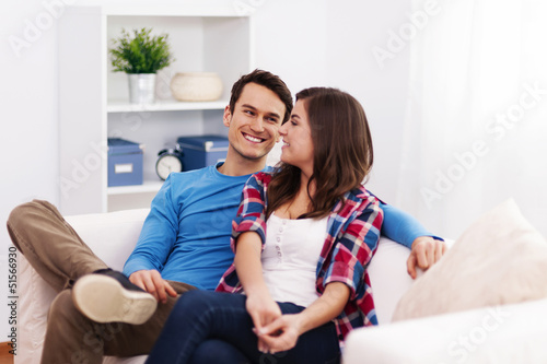Loving couple sitting in living room