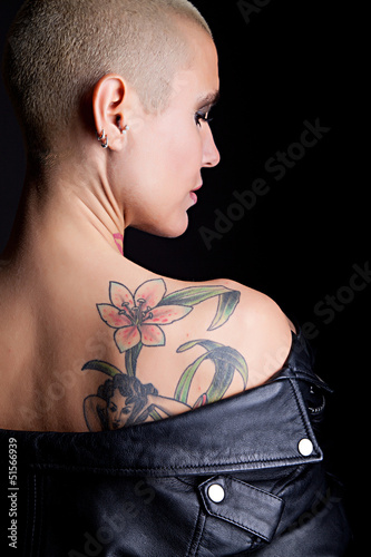 closeup beautiful woman with tattoo and leather jacket