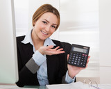 Businesswoman Showing Calculator