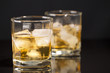 cup of Whiskey on glass background
