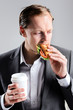 Business man eating lunch in a hurry, stressful lifestyle