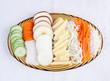 Sliced vegetables display on glass dish