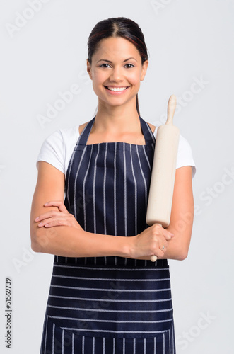 Portrait of a woman chef baker professional