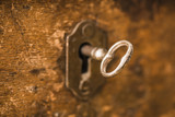 Vintage key in lock of wooden chest