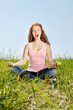 Portrait girl sits on a grass