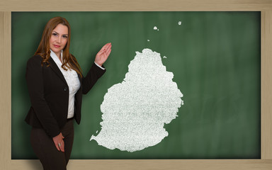 Teacher showing map of mauritius on blackboard