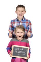 children holding slate