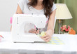 woman working with sewing machine at home