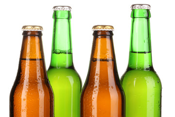 Coloured glass beer bottles isolated on white