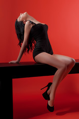Glamour women with long black hair and sexy hairstyle