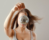 girl with disco ball, isolated on grey background