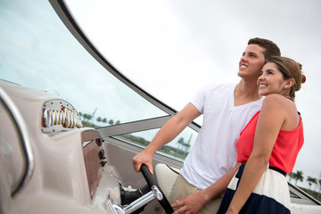 Couple driving a boat