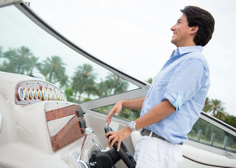 Man behind the wheel of a boat