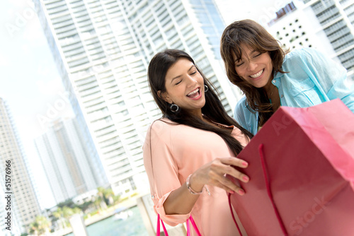 Shopping women looking at bags