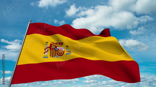 Spain flag waving against time-lapse clouds background