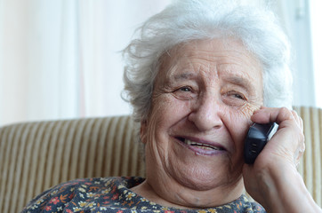 happy senior woman on phone