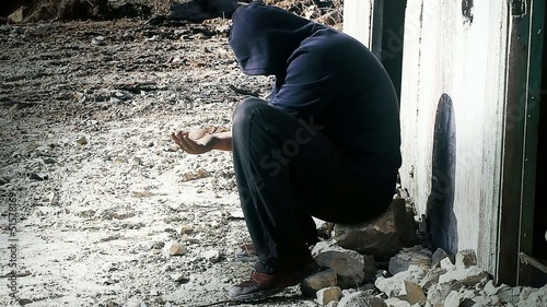 Man given a coins to homeless /with focus to homeless/