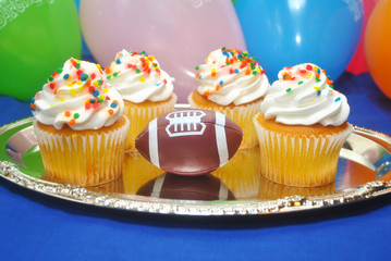 Four Birthday Cupcakes with a Football