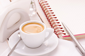 Morning coffee cup and notebook