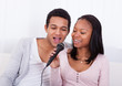 Couple Singing With Microphone
