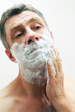 Image of mature man shaving