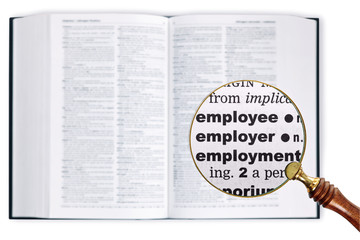 Employee through a magnifying glass over Dictionary.