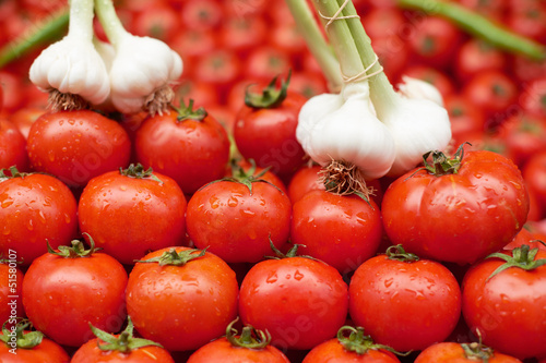 Ripe tomato and garlic for sale