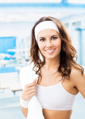 Portrait of young smiling woman at fitness club