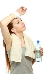 Beautiful sport woman with towel and bottle of water