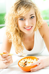 Cheerful woman eating cereal muslin