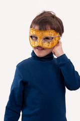 boy wearing a carnival mask, pretending to be a superhero