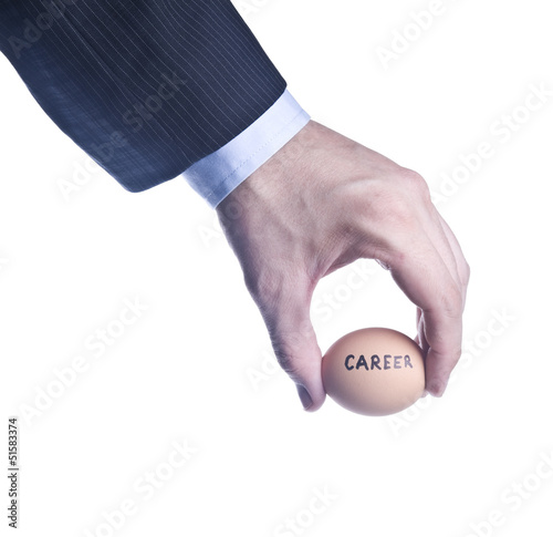 Egg with inscription Career between fingers. Concept of the cris