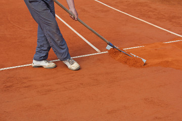 Repairing tennis court