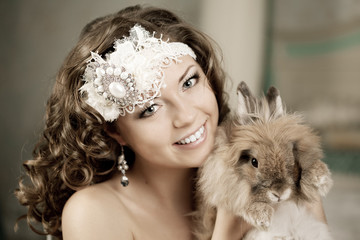 Luxury woman in fashion interior with bunny