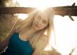 Beautiful blonde girl in the sun