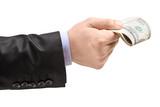 Male hand oferring money