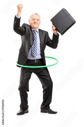 Full length portrait of a matue businessman dancing with a hula