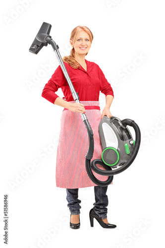 Full length portrait of a woman holding a vacuum cleaner