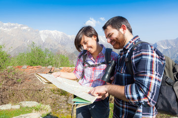 Young Couple Hiking Looking at Map