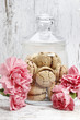 Parisian macarons among pink carnation flowers