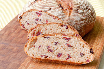Round homemade whole grain bread with cranberry