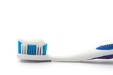 toothbrush with toothpaste on white with clipping path