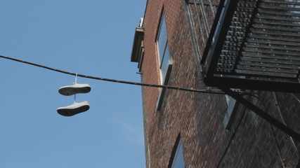 Sneakers hanging from wire. Montreal, Quebec.