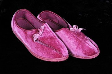 Pair of pink slippers © Arena Photo UK